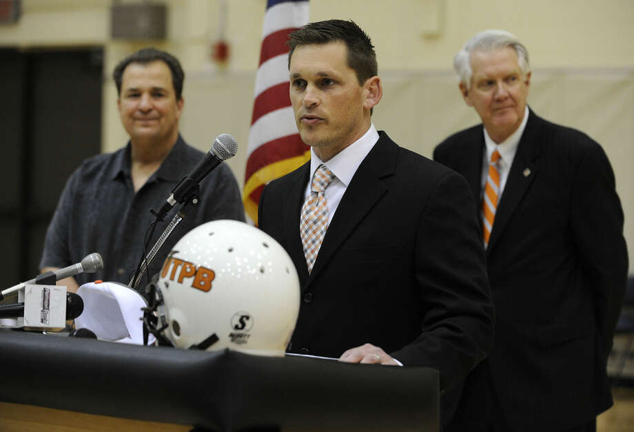 UTPB's new head football coach Justin Carrigan discusses his plans for the program as UTPB Athletic Director Steve Aicinena, left, and UTPB President David Watts stand by during a Friday morning news conference in the Falcon Dome. Carrigan comes to UTPB after three years as offensive coordinator at Tarleton State. Photo: Mark Sterkel|Odessa American