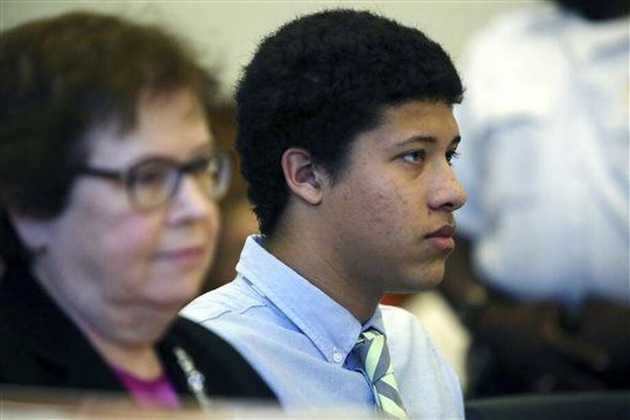 FILE - In this Aug. 12, 2014, file photo, Philip Chism, right, sits with attorney Denise Regan, left, during a hearing in Essex County Superior Court in Salem, Mass. Chism, 15, has been charged as an adult with murder and aggravated rape in the October 2013 slaying of Colleen Ritzer, math teacher at Danvers High School. Chism's public defender, Regan, is expected to argue in Essex County Superior Court on Friday, Jan. 9, 2015, that police never properly read Chism his Miranda rights and continued to question Chism even after he had invoked his right to remain silent and his mother had asked for a lawyer. (AP Photo/The Salem News, Ken Yuszkus, Pool, File) Photo: Ken Yuszkus