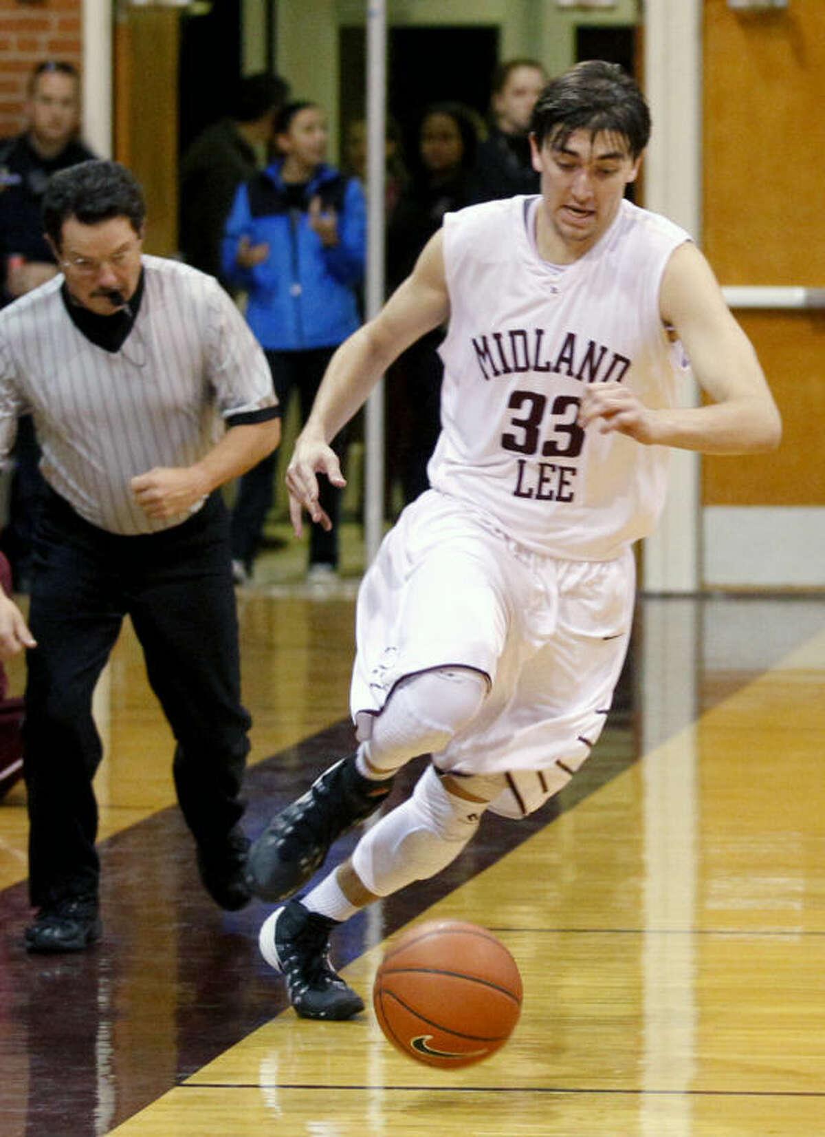 Lee's Jordan Williams (33) takes the ball down the court against Abilene on Thursday at Lee High. James Durbin/Reporter-Telegram