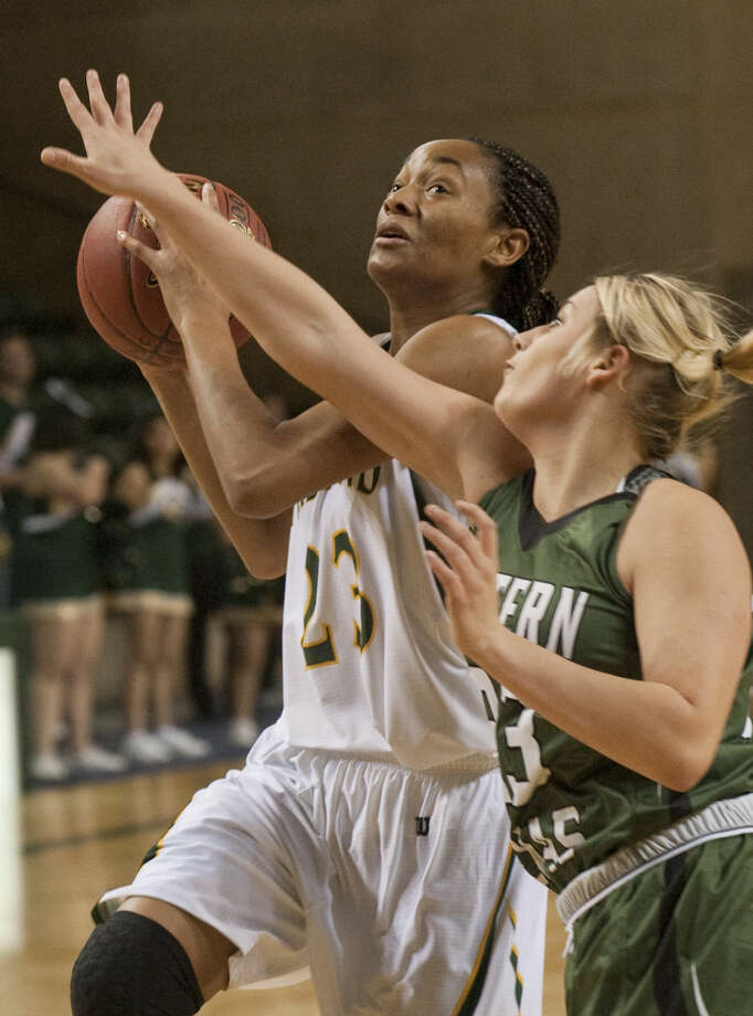Midland College's Mary Savoy looks to the basket as Western Texas' Jocelyn Jeffrey defends Monday evening, 1-12-15, at the Chaparral Center. Tim Fischer\Reporter-Telegram Photo: Tim Fischer