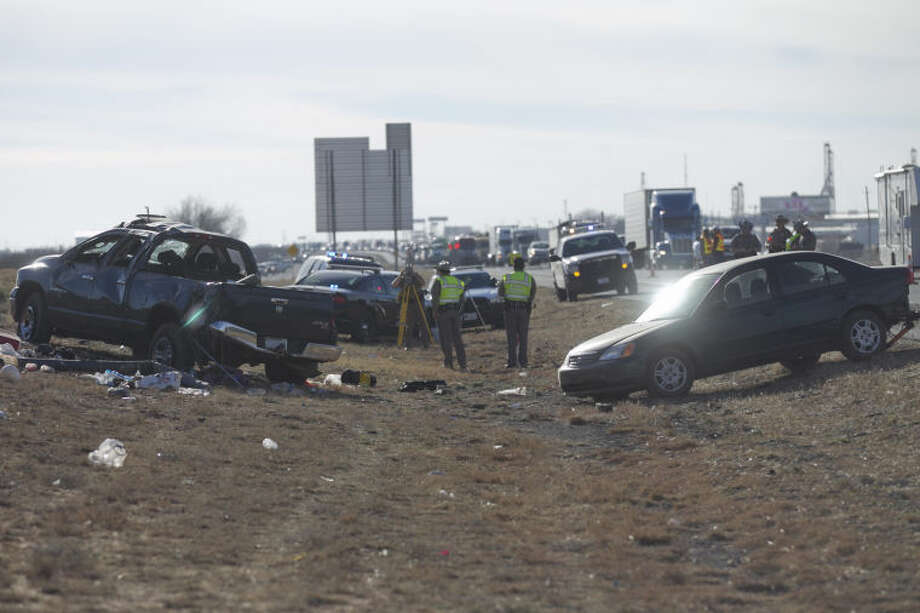 (File Photo) Public safety personnel investigate the scene of a fatal accident near the intersection of I-20 and F.M. 1788 on Thursday. A blue Dodge Ram was towing a green Honda Civic when the Ram lost control and rolled over, ejecting a passenger who was pronounced dead at the scene. James Durbin/Reporter-Telegram Photo: JAMES DURBIN