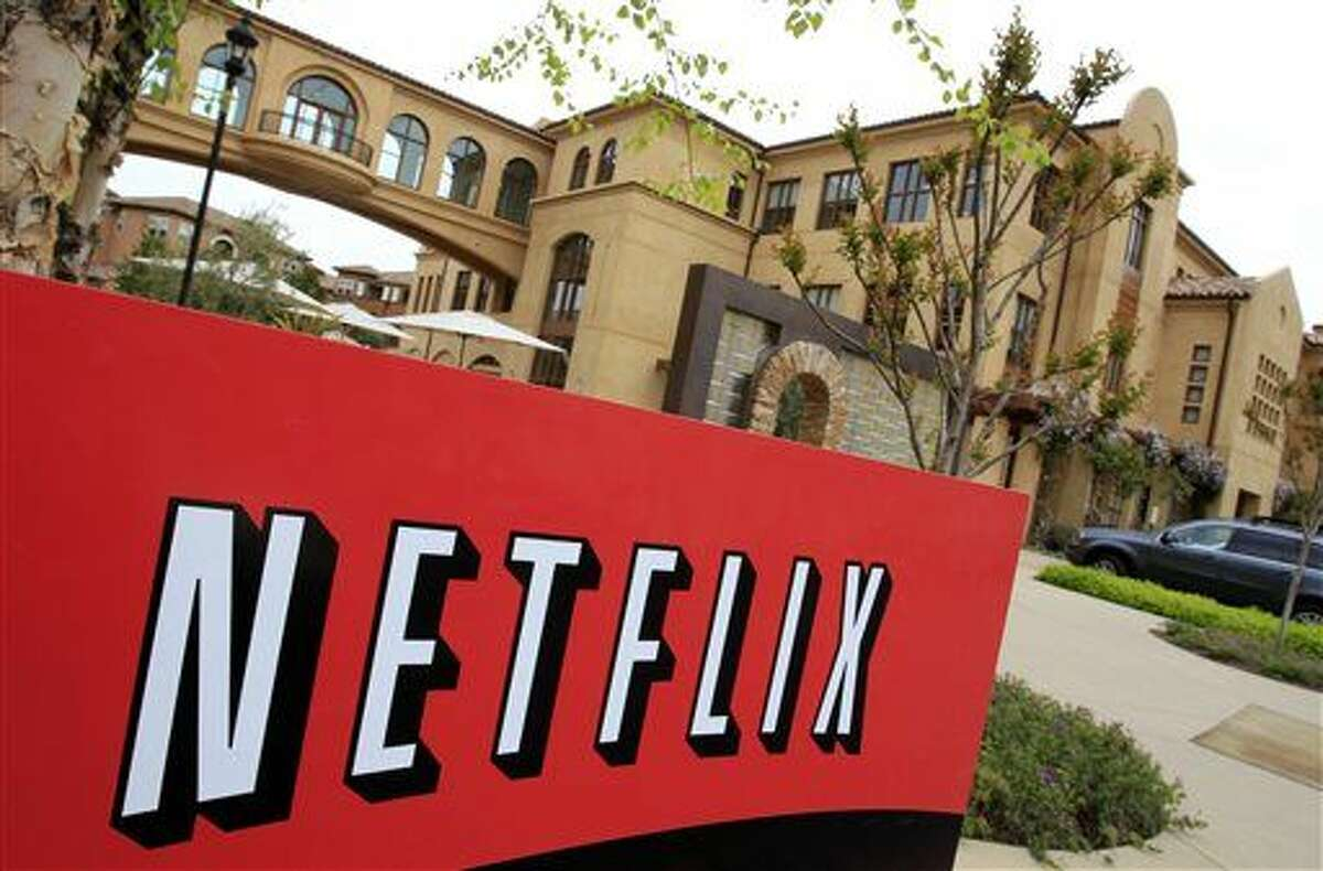 FILE - In this April 22, 2011 file photo, the exterior of Netflix headquarters is shown in Los Gatos, Calif. Even as Netflix continues to pump out more original programming, its bosses say they will continue to keep secret details on how many people are actually watching. The streaming service, with 53 million subscribers, doesn't pay for the third-party ratings service provided by the Nielsen company. (AP Photo/Paul Sakuma, File)