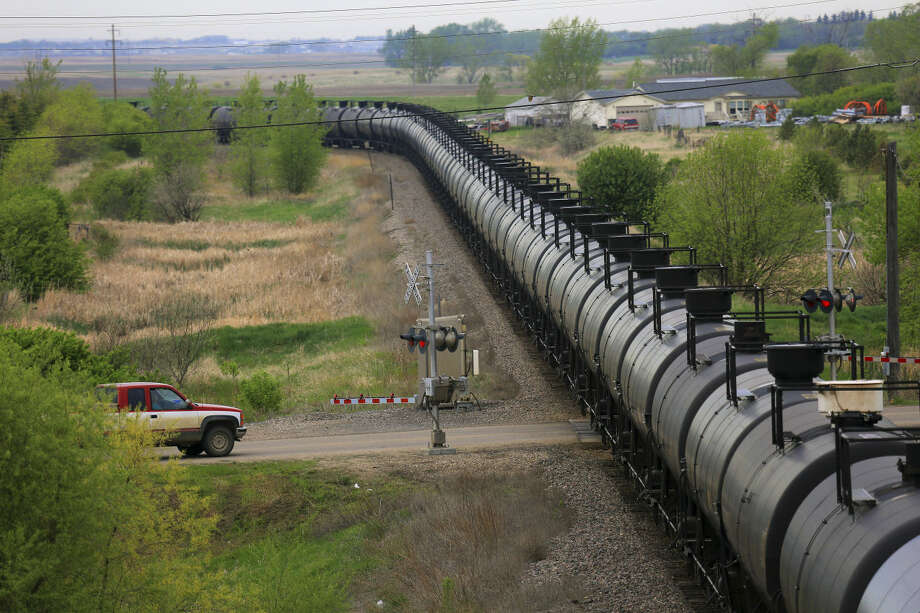 FILE-- An oil train rolls through Surrey, N.D., a state that has become an oil powerhouse, May 29, 2014. Photo: JIM WILSON