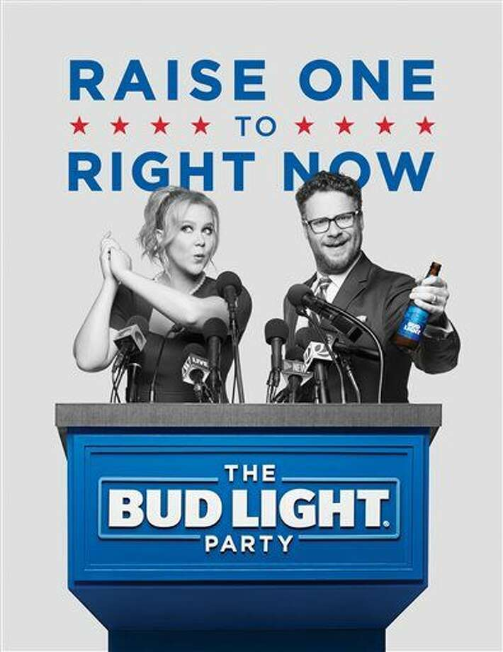 This image provided by Anheuser-Busch shows actors Amy Schumer and Seth Rogen in the company's Bud Light ad for Super Bowl 50. (Anheuser-Busch via AP) Photo: HONS