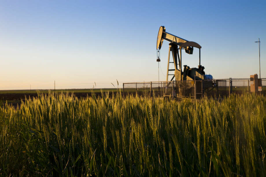 Analysts say falling oil prices are more threat to the balance sheets of smaller companies than large independents like Houston's Apache Corp., which operates this pumping unit in the Adair San Andres field in the Permian Basin of West Texas. Apache Corporation, pump jacks in the Adair San Andreas Unit, Welch, TX. Photo: Apache Corp.