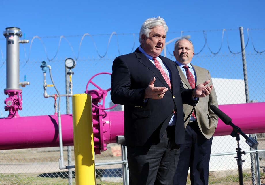 Pioneer Natural Resources President and Chief Operating Officer Tim Dove, left, speaks at a valve turning ceremony Wednesday at the Bob Derrington Water Reclamation Plant. Photo: Edyta Blaszczyk|Odessa American