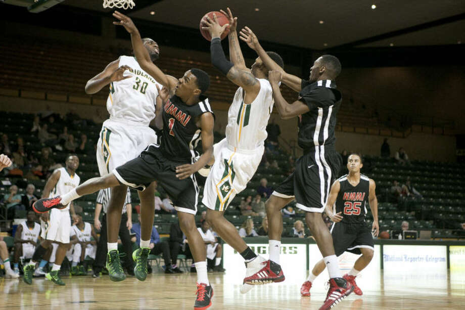 Midland College's Demetric Austin (1) comes down with a rebound during the game against New Mexico on Thursday at Chaparral Center. James Durbin/Reporter-Telegram Photo: JAMES DURBIN