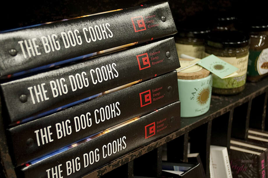 1-12-15 The Big Dog Cooks cookbook. Endeavor Energy and its employees worked together to create a cookbook to be sold as a fundraiser for the West Texas Food Bank. Tim Fischer\Reporter-Telegram Photo: Tim Fischer