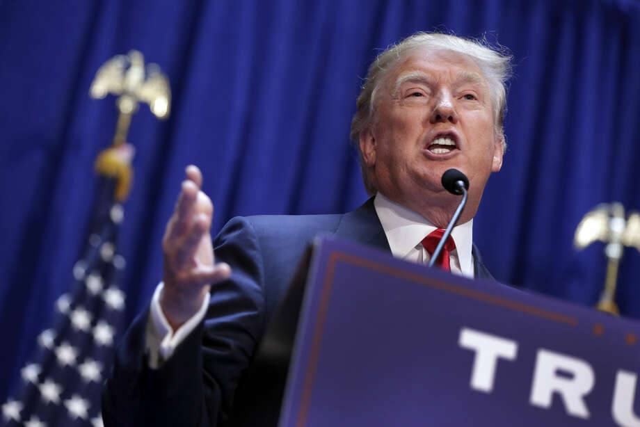 Developer Donald Trump gestures as he announces that he seek the Republican nomination for president, Tuesday, June 16, 2015, in the lobby of Trump Tower in New York. (AP Photo/Richard Drew) Photo: Richard Drew