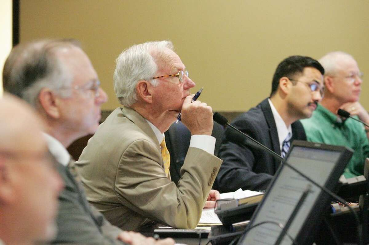 (File Photo) Jimmy Smith, from left, Robin Donnelly; Judge Mike Bradford, Luis Sanchez, and Randy Prude listen to citizens during the Commissioners Court public hearing at the Midland County Courthouse in the file photo. Cindeka Nealy/Reporter-Telegram