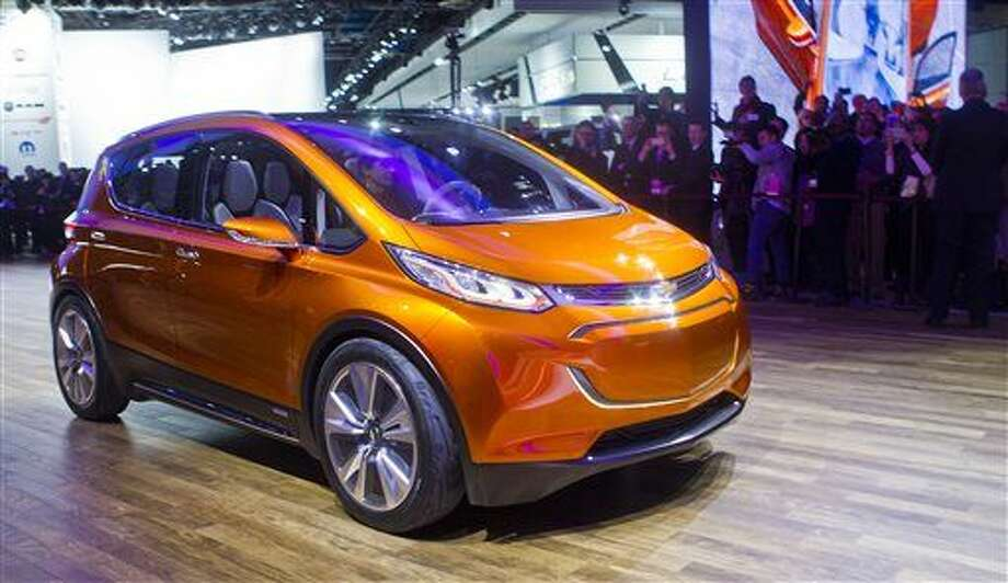 The Chevrolet Bolt EV electric concept vehicle is driven onto the stage at a presentation during the North American International Auto Show, Monday, Jan. 12, 2015, in Detroit. (AP Photo/Tony Ding) Photo: Tony Ding