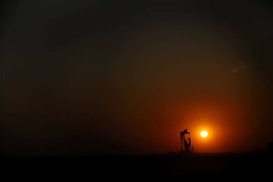 The sun sets behind a pumpjack near FM 829, March 26 in Stanton. Photo: JAMES DURBIN