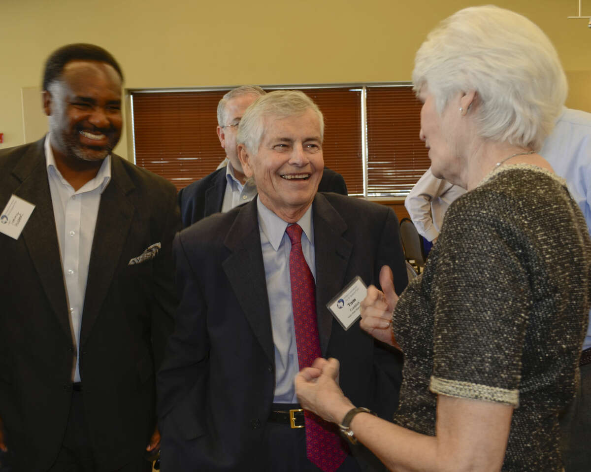 State Rep. Tom Craddick, center, speaks with City Council member Sharla Hotchkiss and Deputy City Manager Tommy Hudson at an XCOR event last year. Craddick is set to become the longest-serving legislator in the state's history.