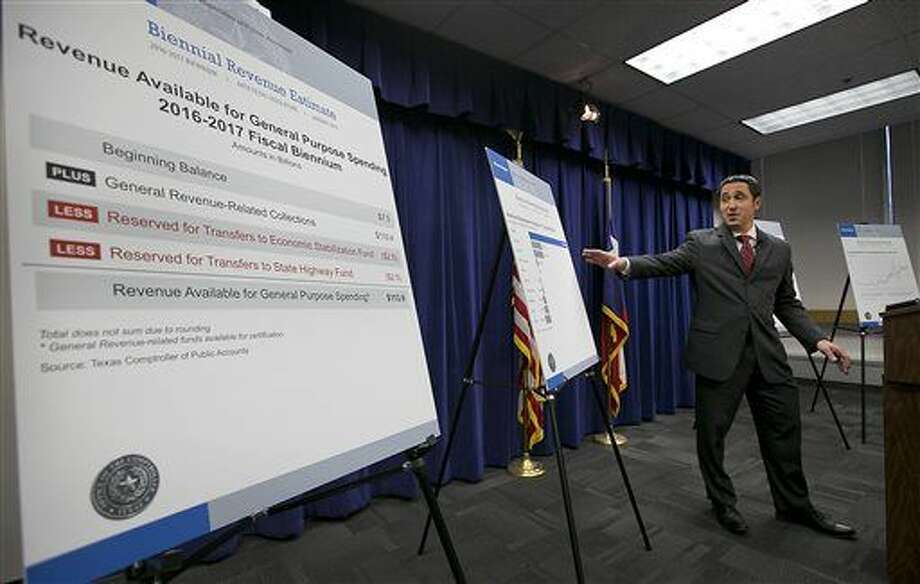 Texas State Comptroller Glenn Hegar announces an overwhelmingly Republican Legislature will have $113 billion in revenue to spend over the next two years, at an announcement made on Monday, Jan. 12, 2015, in Austin, Texas, the day before the 84th legislature is sworn into office. (AP Photo/Austin American-Statesman, Ralph Barrera) AUSTIN CHRONICLE OUT, COMMUNITY IMPACT OUT, INTERNET AND TV MUST CREDIT PHOTOGRAPHER AND STATESMAN.COM, MAGS OUT Photo: Ralph Barrera