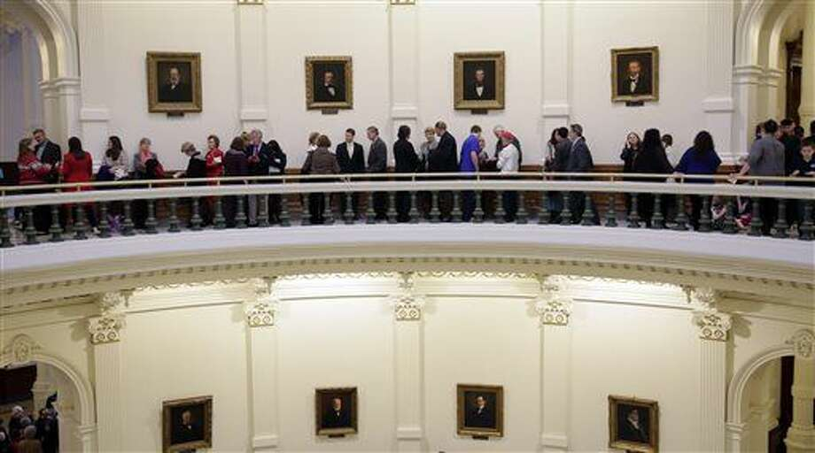 Visitor line up in the Texas Capitol to enter the House Chambers for the beginning of the 2015 legislative session, Tuesday, Jan. 13, 2015, in Austin, Texas. (AP Photo/Eric Gay) Photo: Eric Gay