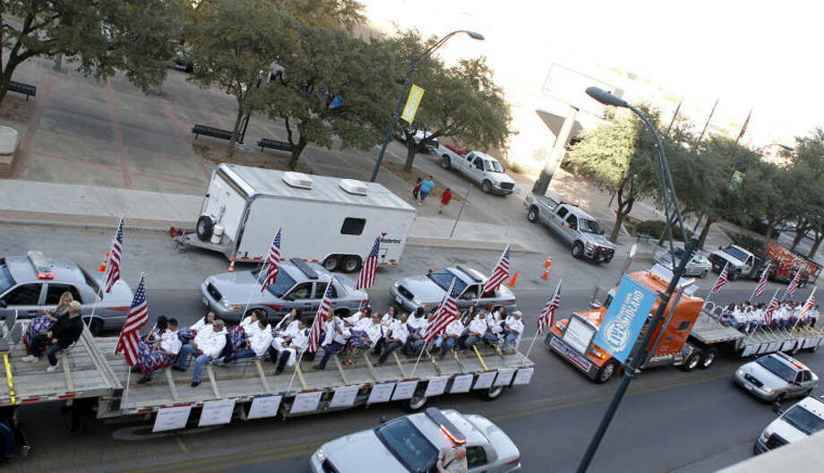 PREVIOUSLY UNRELEASED FILE PHOTO / Flatbed trucks carrying wounded veterans and their families drive down Wall Street during the Show of Support parade Nov. 15, 2012, in Midland. The flatbed truck on the far right of the image was struck by a train at a crossing on Garfield St., killing four and injuring 14. Photo: James Durbin/Repoter-Telegram