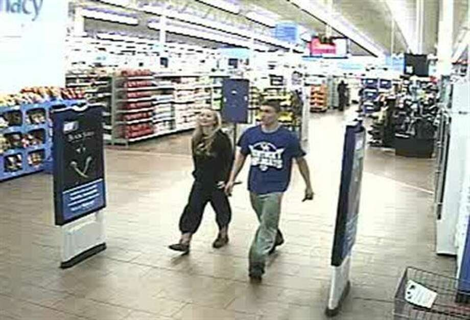 In this January 2015 photo made from surveillance video and released by the Grayson County Sheriff's Office, in Kentucky, 18-year-old Dalton Hayes and 13-year-old Cheyenne Phillips leave a South Carolina Wal-Mart. Authorities are looking for the teenage couple from central Kentucky who are suspected in a multistate crime spree. (AP Photo/Wal-Mart Inc. via The Grayson County (Ky.) Sheriff's Office) Photo: HONS
