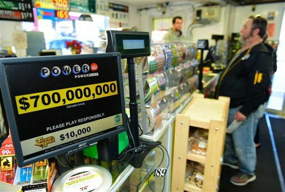 Jerry Clark buys Powerball lotter tickets, Thursday, Jan. 7, 2016 at Bill's Kwik Chek in Chambersburg, Pa. The estimated prize for this weekend's Powerball drawing has grown to about $700 million, making it the largest jackpot of any lottery game in U.S. history. (Markell DeLoatch(/Public Opinion via AP) HERALD-MAIL OUT; THE RECORD HERALD OUT; MANDATORY CREDIT Photo: Markel DeLoatch