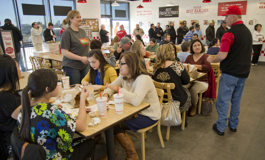Midlanders wait in line Thursday 01-07-16 to try Five Guys burgers during the lunch opening. Tim Fischer\Reporter-Telegram Photo: Tim Fischer