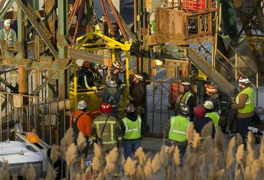The last of 17 Cargill salt miners emerge Thursday, Jan. 7, 2016, after being rescued from an elevator stuck 900 feet below the surface at the Cayuga Salt Mine, in Lansing, N.Y. A rescue cage was lowered from a crane to bring them up four at a time. (Simon Wheeler/The Ithaca Journal via AP, Pool) Photo: Simon Wheeler