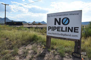 An anti-pipeline sign sits right outside of a Pumpco site in the neighborhood of Sunny Glen. Pumpco cleared the 20+ acre sight months ago in preparation to use it for the construction of the Trans-Pecos Pipeline