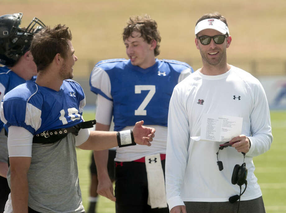 Texas Tech football head coach Kliff Kingsbury talks with quarterback Michael Brewer on the sidelines during the Texas Tech spring football practice in April at Grande Communications Stadium. Davis Webb (7) is in the background.James Durbin/Reporter-Telegram Photo: JAMES DURBIN