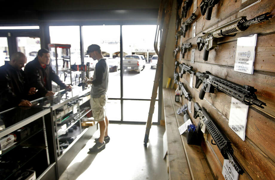 Justin Smith shows AR-15 compete lower receivers to a customer who is assembling his first AR-15, Thursday, Dec. 10, 2015, at SK Arms. James Durbin/Reporter-Telegram Photo: James Durbin
