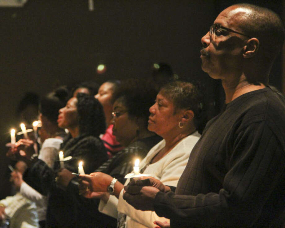 Midlanders hold up candles during a vigil Monday night to honor the life and work of Dr. Martin Luther King Jr. Tyler White/Reporter-Telegram Photo: Tyler White