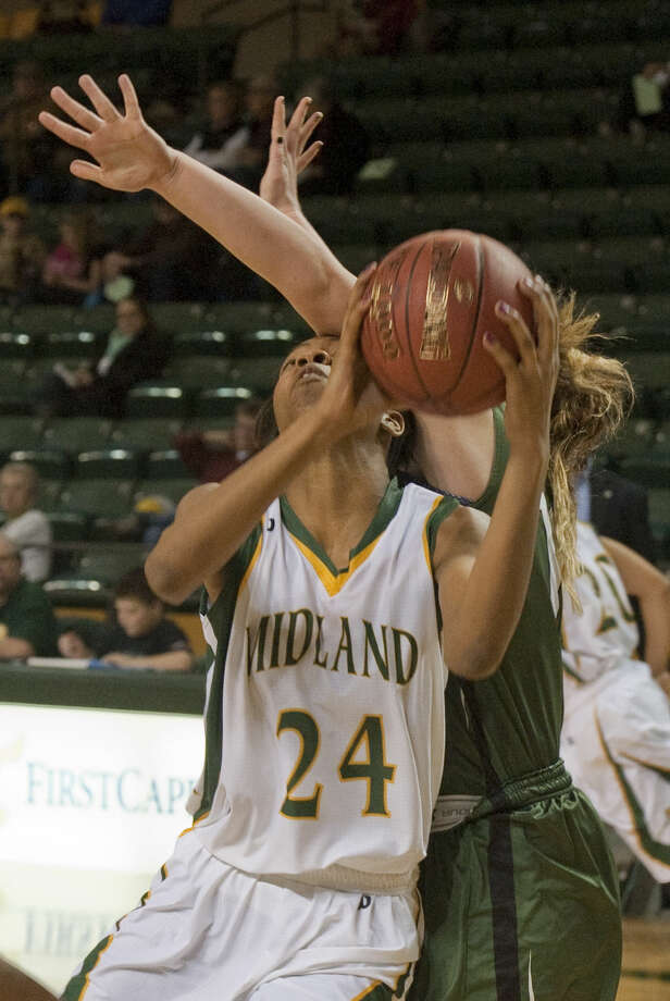 Midland College's Walnatia Wright goes up for a shot as she is fouled by Western Texas' Kendall Festervand Monday evening, 1-12-15, at the Chaparral Center. Tim Fischer\Reporter-Telegram Photo: Tim Fischer