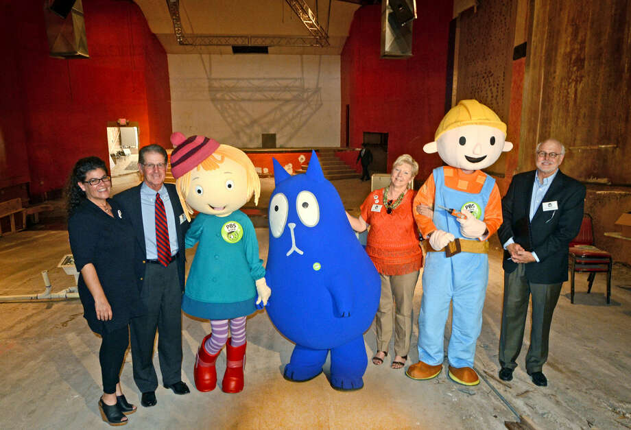 From left, Alyson Trevino, Basin PBS creative director, Frank Deaderick, Basin PBS board chair, PBS characters Peg and Cat, Molly Murphy, Basin PBS development director, Bob the Builder, and Jim Rhotenberry, chief architect, pose for a photo after a press conference Sept. 9, announcing the Ritz Theater as the new home for Basin PBS. James Durbin/Reporter-Telegram Photo: James Durbin