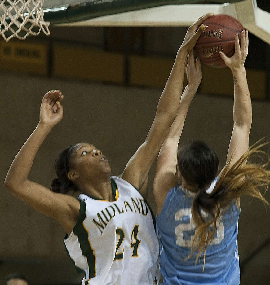 Midland College's Walnatia Wright gets a block as Odessa College's Anushka Maldonado tries to put up a shot Monday, 1-19-15, at the Chaparral Center. Tim Fischer\Reporter-Telegram Photo: Tim Fischer