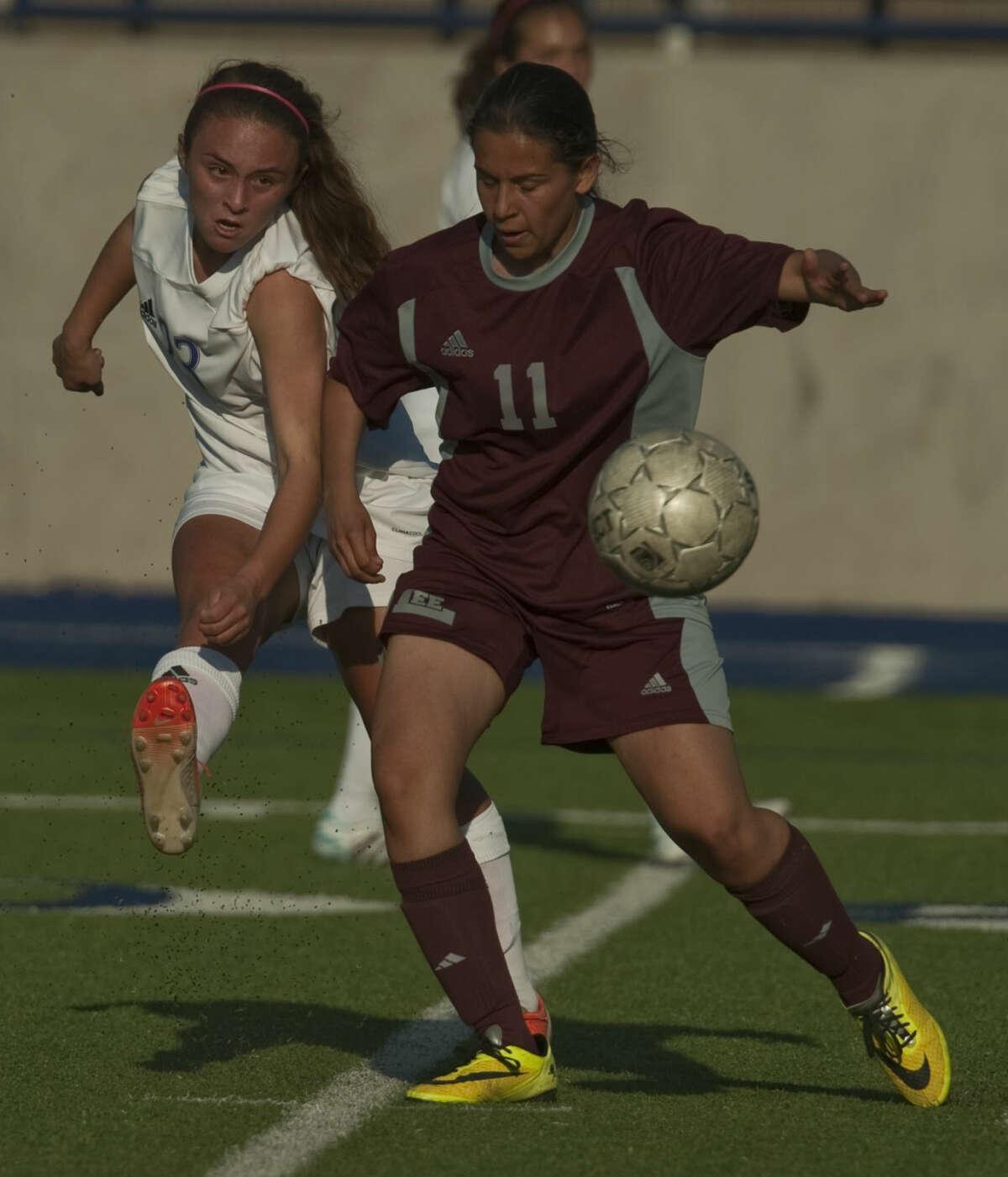Midland High's Adrienne Almadova gets the ball around Lee's Brianna Herrera Tuesday, 03-10-15, at Grande Comminications Stadium. Tim Fischer\Reporter-Telegram