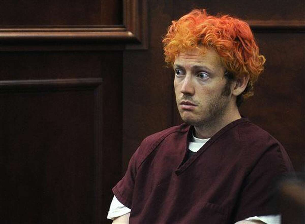 FILE - In this July 23, 2012 file photo, James Holmes, who is charged with killing 12 moviegoers and wounding 70 more in a shooting spree in a crowded theatre in Aurora, Colo., in July 2012, sits in Arapahoe County District Court in Centennial, Colo. Holmes' trial is set to start on Tuesday, Jan. 20, 2015. (AP Photo/Denver Post, RJ Sangosti, Pool, File)