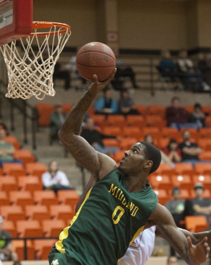 Midland College's Torren Jones puts up a turn around in front of Howard College's Travis Charles in this Dec. 3, 2014 photo at Dorothy Garrett Coliseum. Tim Fischer\Reporter-Telegram Photo: Tim Fischer
