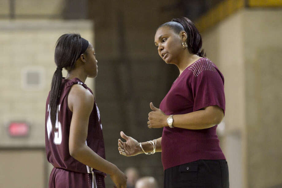 Lee girls basketball head coach Monica Ramirez talks with Bri'An Washington (15) on on Jan. 7 at Chaparral Center. James Durbin/Reporter-Telegram Photo: JAMES DURBIN
