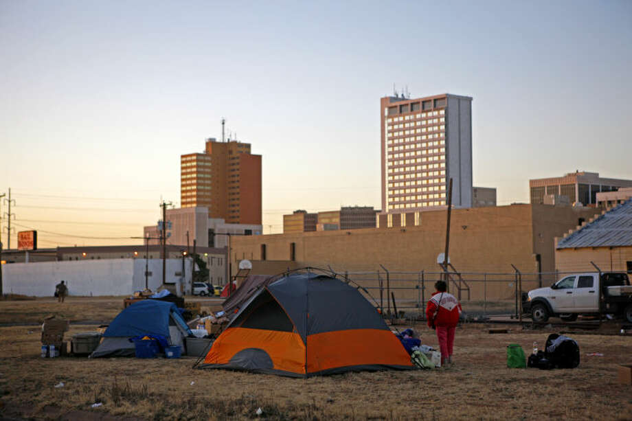 Homeless residents of a vacant lot on Baird and Washington pack their belongings after the City of Midland declared they must vacate the lot they were camping on and move elsewhere Friday. James Durbin/Reporter-Telegram Photo: JAMES DURBIN