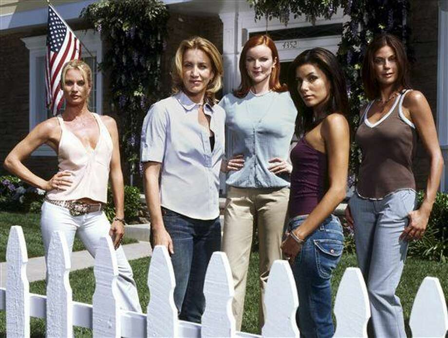"""FILE - In this 2004, file photo, originally released by ABC, the stars of the network's hit primetime series, """"Desperate Housewives,""""from left, Nicollette Sheridan, Felicity Huffman, Marcia Cross, Eva Longoria and Teri Hatcher pose on the set in Los Angeles. Marc Cherry, who created the series, also created the Lifetime series, """"Devious Maids."""" (AP Photo/ABC, Moshe Brakha, File) Photo: Moshe Brakha"""
