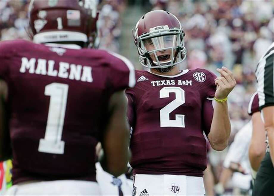 Texas A&M's Johnny Manziel (2) celebrates a touchdown with teammate Ben Malena (1) during the fourth quarter of an NCAA college football game against Rice on Aug. 31, 2013 in College Station. (AP Photo/Eric Gay) Photo: Eric Gay / AP