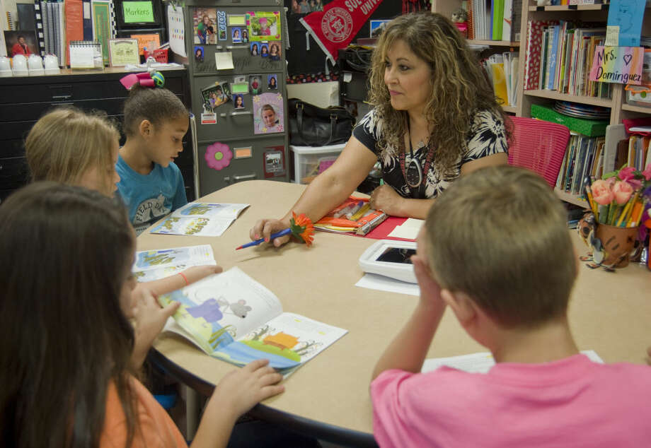 Lisa Dominguez, a Classroom Pioneer with Pease Magnet School, works with her second graders Friday 9-16-2015. Tim Fischer\Reporter-Telegram Photo: Tim Fischer