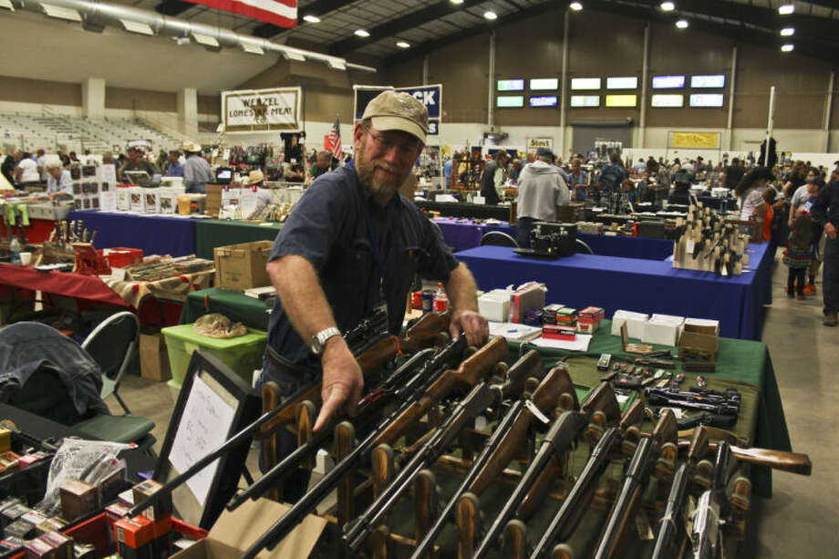 Many people visited the Horseshoe Sunday afternoon for the second day of the Silver Spur Gun and Blade Show. Vendors offered a myriad of handguns, rifles, shotguns and blades for interested customers. Firearm accessories and other weapons also were on display for purchase. Kim Sansom, coordinator for Silver Spur Trade Shows, said this show saw 25 percent or more different vendors than were present during February's gun and blade show, which brought in record-high sales for the organization. Photo: TYLER WHITE
