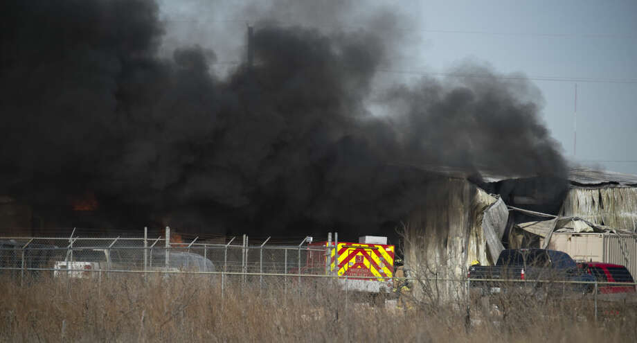 Midland fire units respond to an explosion and fire at a facility off NCR 1140 Monday 01-04-15 morning. Multiple smaller explosions could be heard as first responders start to contain the blaze. Tim Fischer\Reporter-Telegram Photo: Tim Fischer