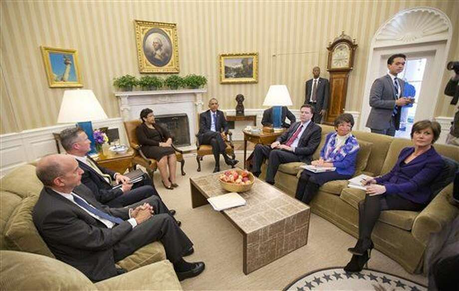 President Barack Obama meets with top law enforcement officials in the Oval Office of the White House in Washington, Monday, Jan. 4, 2016, to discuss executive actions the president can take to curb gun violence. The president is slated to finalize a set of new executive actions tightening U.S. gun laws, kicking off his last year in office with a clear signal that he intends to prioritize one of the country's most intractable issues. From left are: Counsel to the President Neil Eggleston, acting ATF Director Thomas Brandon, Attorney General Loretta Lynch, FBI Director James Comey, White House Senior Adviser Valerie Jarrett, and Deputy Attorney General Sally Yates, (AP Photo/Pablo Martinez Monsivais) Photo: Pablo Martinez Monsivais