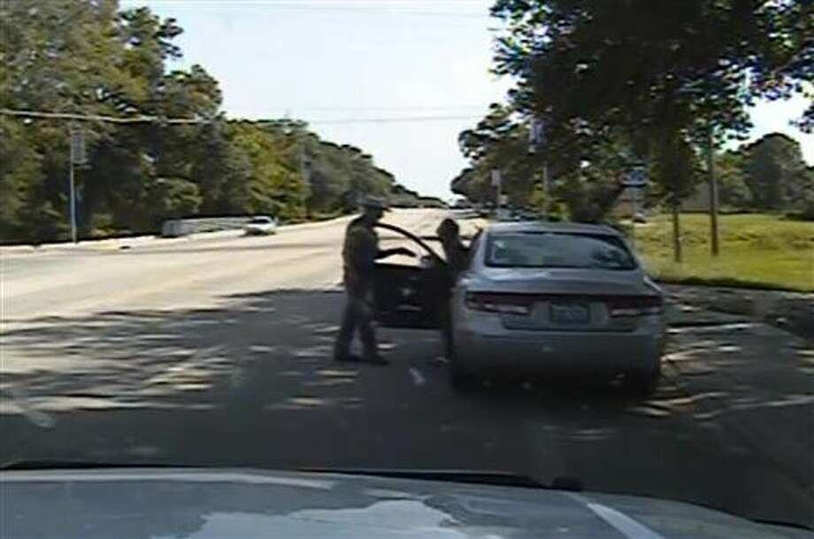 FILE - In this July 10, 2015, file frame from dashcam video provided by the Texas Department of Public Safety, Texas State Trooper Brian Encinia confronts Sandra Bland after a minor traffic infraction in Waller County,Texas. A grand jury decided that neither sheriff's officials nor jailers committed a crime in the treatment of Bland, a black woman who died in a Texas county jail last summer. But it has not yet determined whether Encinia, who arrested her, should face charges, a prosecutor said on Tuesday, Dec. 22, 2015. (Texas Department of Public Safety via AP, file) Photo: Uncredited