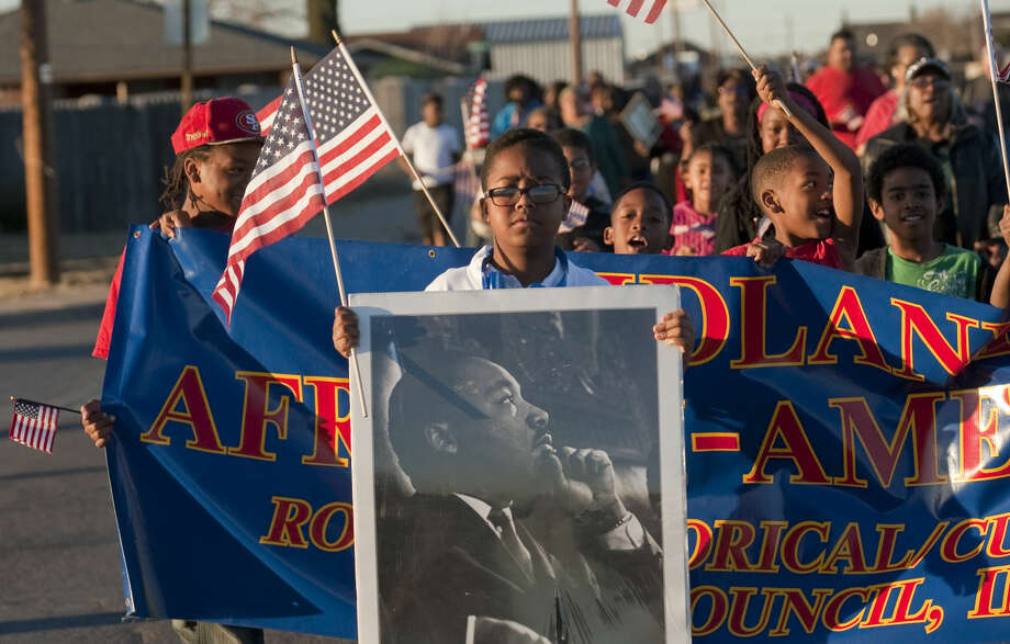 Jakylan Fuller Reed leads the MLK march Monday, 1-19-15, as Midlanders come together to remember Dr. Martin Luther King Jr.. Tim Fischer\Reporter-Telegram Photo: Tim Fischer