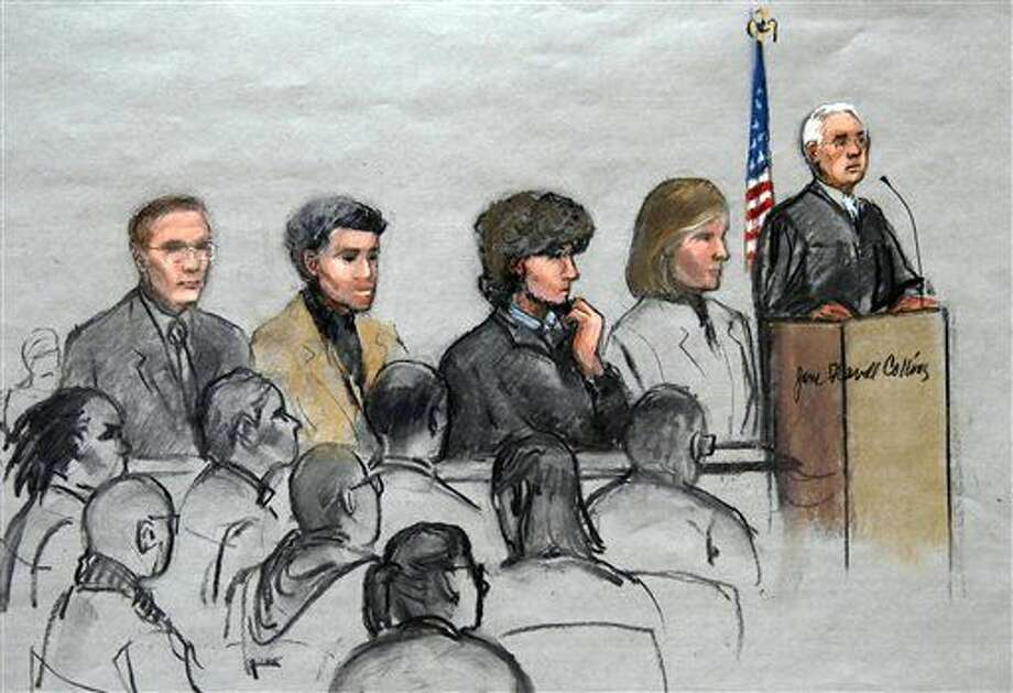 In this courtroom sketch, Boston Marathon bombing suspect Dzhokhar Tsarnaev, third from right, is depicted with his lawyers and U.S. District Judge George O'Toole Jr., right, as O'Toole addresses a pool of potential jurors in a jury assembly room at the federal courthouse, Tuesday, Jan. 6, 2015, in Boston. Tsarnaev is charged with the April 2013 attack that killed three people and injured more than 260. His trial is scheduled to begin on Jan. 26. He could face the death penalty if convicted. (AP Photo/Jane Flavell Collins) Photo: Michael Dwyer