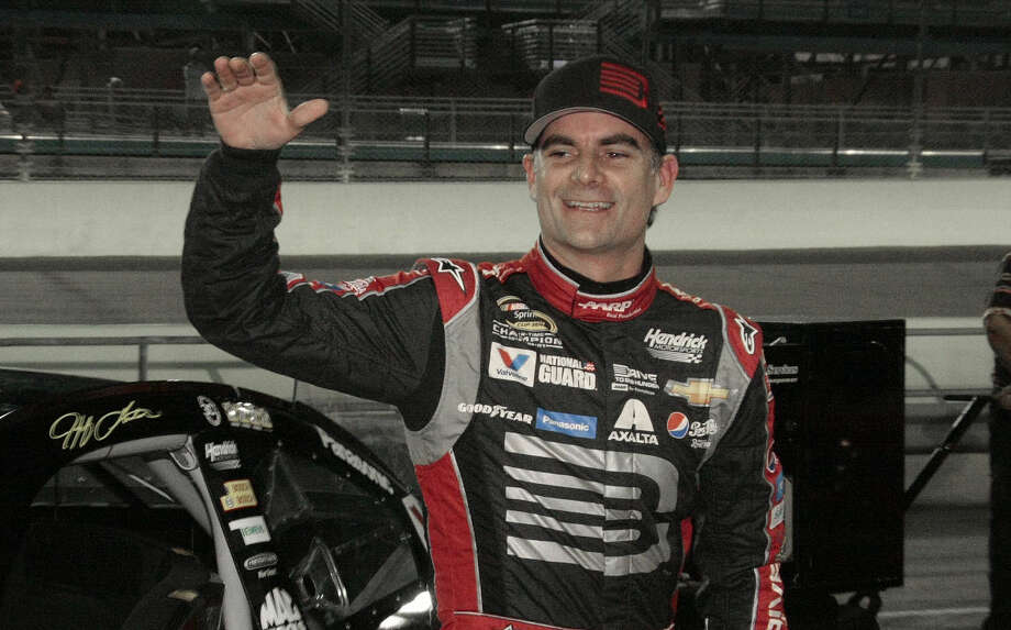FILE - In this Nov. 14, 2014, file photo, Jeff Gordon celebrates after qualifying laps for the EcoBoost 400 auto race in Homestead, Fla. Gordon says he will retire as a full-time driver after the 2015 season. (AP Photo/Darryl Graham, File) Photo: Darryl Graham