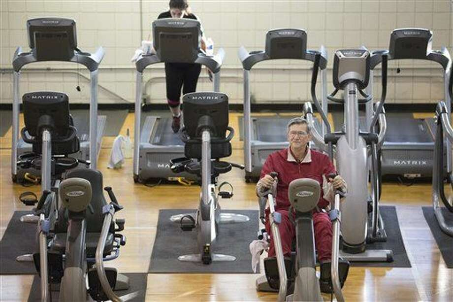 In this photo taken Dec. 22, 2015, Glendon Bassett does a cardio workout at the Family YMCA in Hot Springs, Ark. Bassett, a retired chemical engineer, says he can vouch for the teamwork approach Medicare is promoting. Earlier this year, a primary care team at SAMA Healthcare in El Dorado, Arkansas, prevented what Bassett feared would turn into an extended hospitalization. It started with a swollen leg. (AP Photo/Evan Lewis) Photo: Evan Lewis
