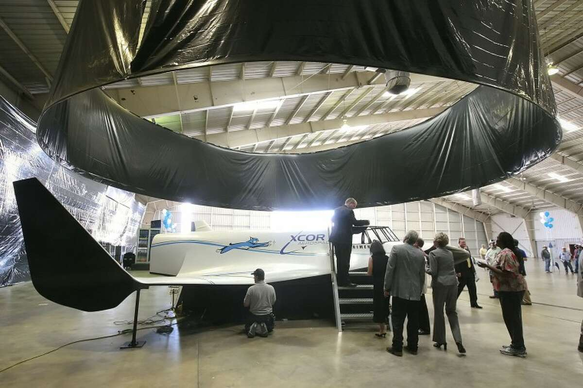(FILE PHOTO) People gather around to get a closer look at a full scale model of the XCOR Aerospace Lynx rocket Monday following a ceremony officially announcing the companies' relocation of its executive office's to Midland. Cindeka Nealy/Reporter-Telegram