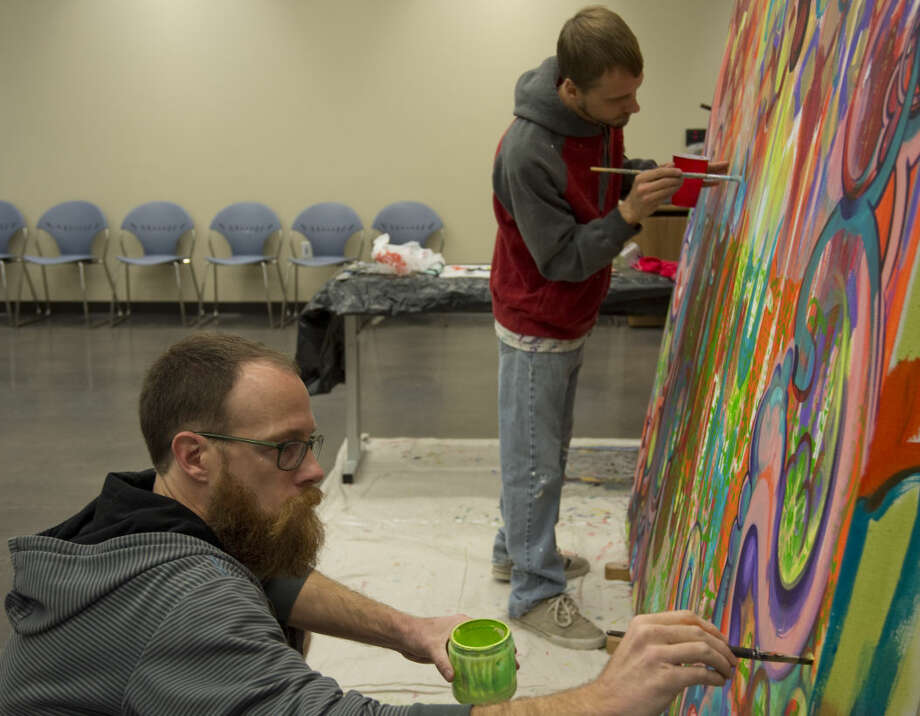 Brothers Elliott and Scott Lunson work on a piece Monday 12-21-2015 at the Centennial Library as part of their Artist in Residence at the library. Tim Fischer\Reporter-Telegram Photo: Tim Fischer