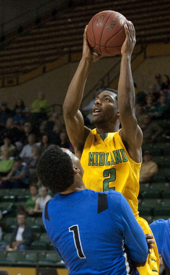 Midland College's Tyler Whitehead pulls up for a shot as Odessa College's Devarus Craig is called for a block Monday, 1-19-15, at the Chaparral Center. Tim Fischer\Reporter-Telegram Photo: Tim Fischer